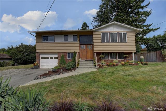 7220 NE 153rd St, Kenmore, WA 98028 (#1358815) :: Real Estate Solutions Group