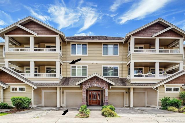 23925 NE 115th Lane #204, Redmond, WA 98053 (#1358827) :: Homes on the Sound