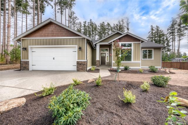 136 Woodland Dr, Camano Island, WA 98282 (#1360686) :: Kimberly Gartland Group
