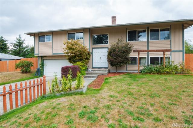 7024 46th Ave E, Tacoma, WA 98443 (#1361228) :: Homes on the Sound