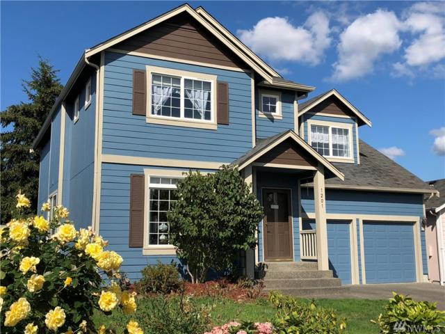 1201 130th St E, Tacoma, WA 98445 (#1361245) :: Keller Williams - Shook Home Group