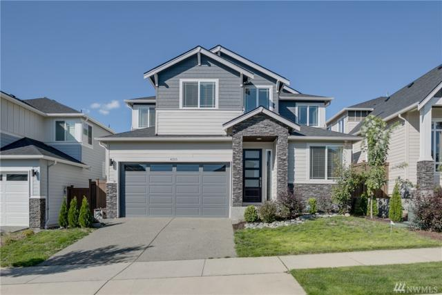 4125 172nd Place SE, Bothell, WA 98012 (#1363037) :: Carroll & Lions
