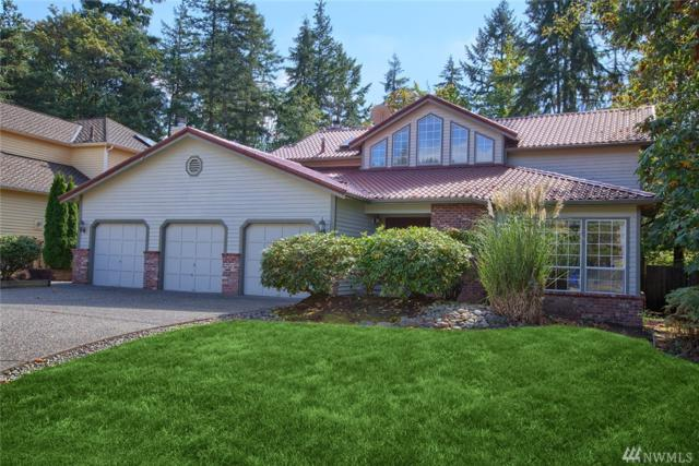 14735 SE 66th St, Bellevue, WA 98006 (#1363337) :: Homes on the Sound