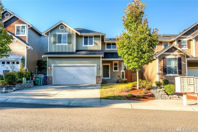 12870 NE 197th Place, Woodinville, WA 98072 (#1363710) :: Carroll & Lions