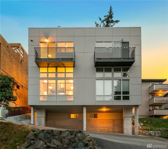 3404 23rd Ave W A, Seattle, WA 98199 (#1363755) :: Carroll & Lions