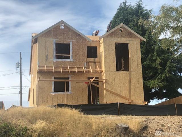 1340 S Highland Ave, Tacoma, WA 98465 (#1365332) :: KW North Seattle