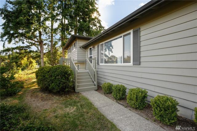 9529 NE 137th St, Kirkland, WA 98034 (#1368568) :: Real Estate Solutions Group