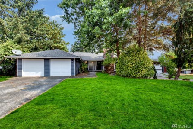 14920 SE 49th St, Bellevue, WA 98006 (#1369950) :: Real Estate Solutions Group