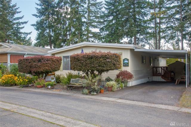 18425 NE 95th St #102, Redmond, WA 98052 (#1371925) :: Mike & Sandi Nelson Real Estate