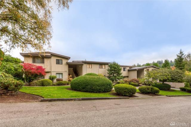10032 SE 6th St #203, Bellevue, WA 98004 (#1372573) :: Real Estate Solutions Group