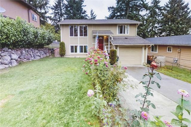 1217 E 60th St, Tacoma, WA 98404 (#1373916) :: Mike & Sandi Nelson Real Estate