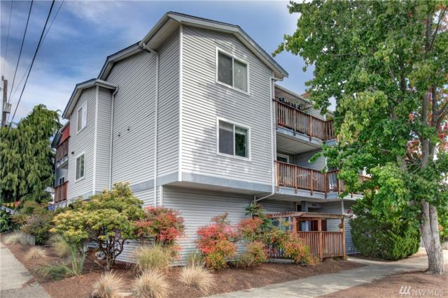 7000 Cleopatra Place NW #201, Seattle, WA 98117 (#1375620) :: Chris Cross Real Estate Group