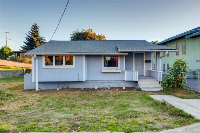 815 SW Cloverdale St, Seattle, WA 98106 (#1376474) :: Kwasi Bowie and Associates