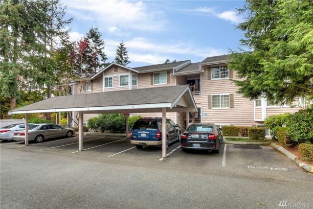 14037 NE 181st St C201, Woodinville, WA 98072 (#1376942) :: KW North Seattle