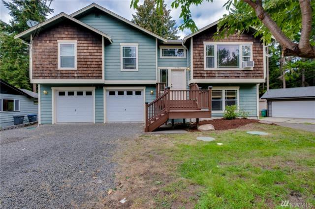 7930 NE Seawind Ave, Poulsbo, WA 98370 (#1377420) :: Real Estate Solutions Group