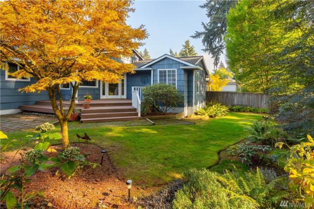 10409 SE 22nd St, Bellevue, WA 98004 (#1378493) :: Keller Williams Western Realty