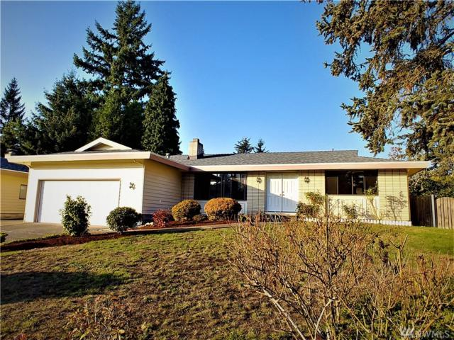 12826 SE 67th St, Bellevue, WA 98006 (#1379429) :: Real Estate Solutions Group