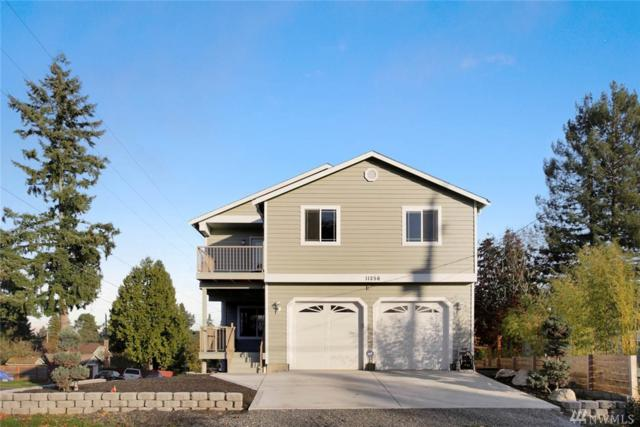 11256 Fremont Ave N, Seattle, WA 98133 (#1383117) :: The DiBello Real Estate Group