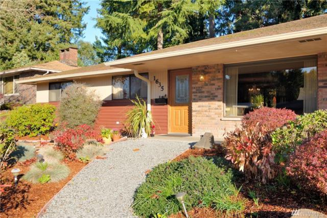 1635 S Woodlawn St, Tacoma, WA 98465 (#1384440) :: Keller Williams Realty