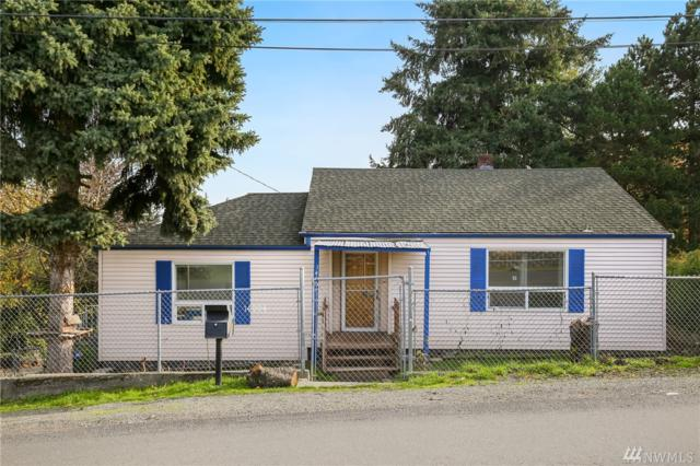 14004 29th Ave S, SeaTac, WA 98168 (#1384728) :: Beach & Blvd Real Estate Group
