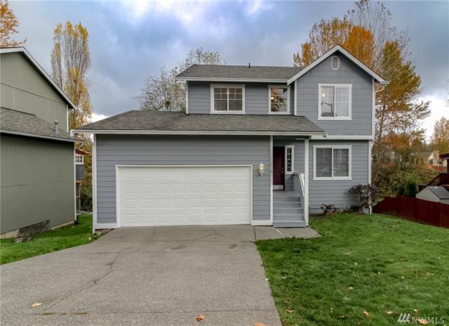 11716 SE 264th Place, Kent, WA 98030 (#1384767) :: McAuley Real Estate
