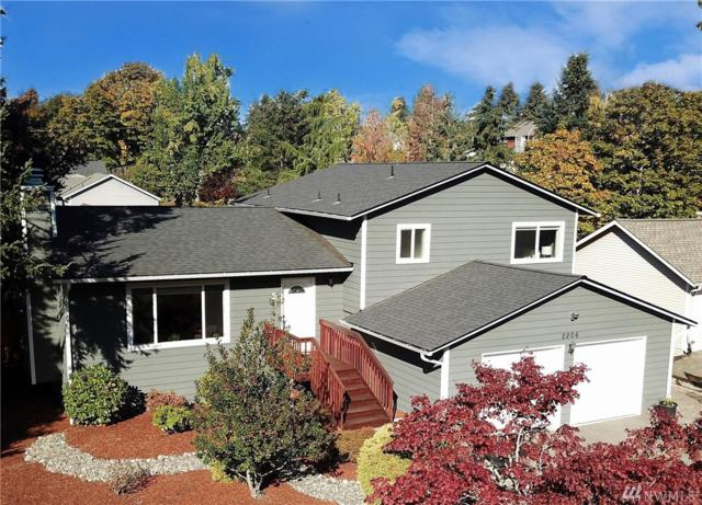 2206 NE 23rd St, Renton, WA 98056 (#1385148) :: McAuley Real Estate