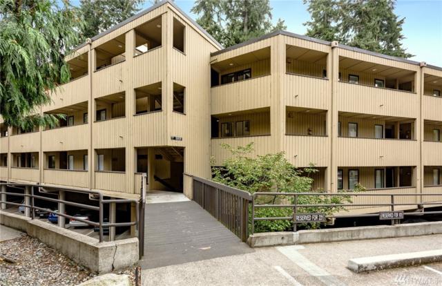 10819 NE 37th Place #106, Bellevue, WA 98004 (#1385845) :: Pickett Street Properties