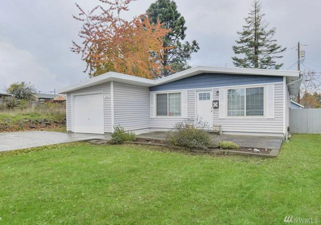 215 E 61st St, Tacoma, WA 98404 (#1386081) :: NW Home Experts