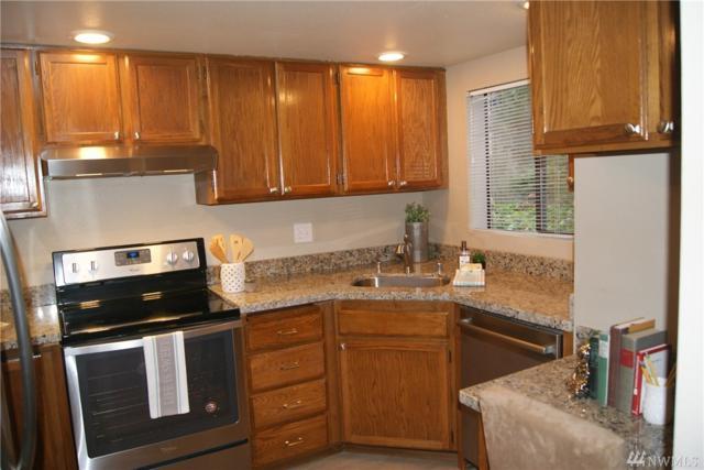 15254 Sunwood Blvd E12, Tukwila, WA 98188 (#1386892) :: Keller Williams Everett