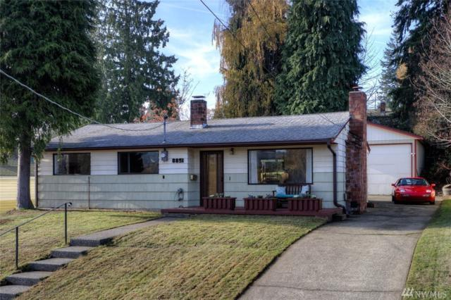 8851 28th Ave SW, Seattle, WA 98126 (#1387605) :: Hauer Home Team