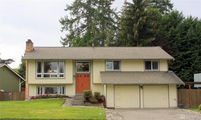 12021 82nd Place NE, Kirkland, WA 98034 (#1388005) :: Beach & Blvd Real Estate Group