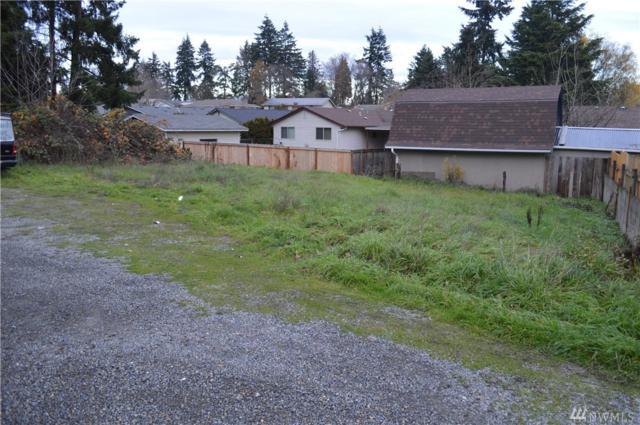 705 S 96th St, Tacoma, WA 98444 (#1390872) :: Keller Williams Realty