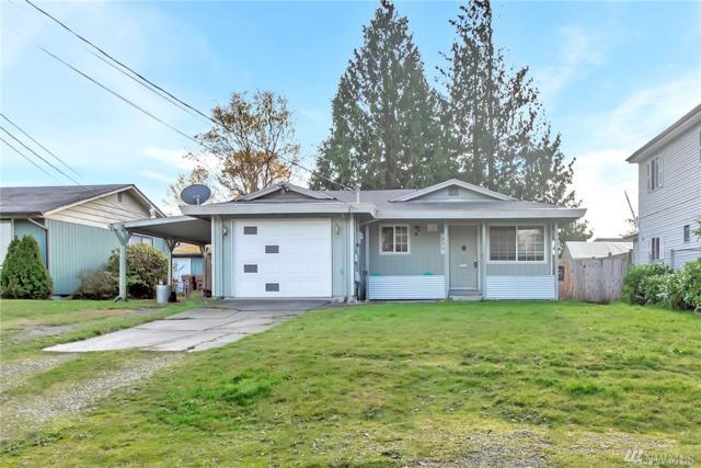 606 E 69th St, Tacoma, WA 98404 (#1392057) :: Kimberly Gartland Group