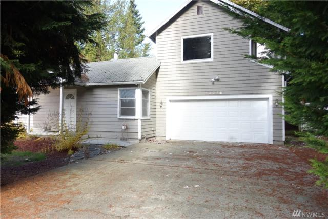 13218 NE 70th, Kirkland, WA 98033 (#1393949) :: Carroll & Lions