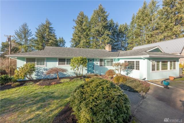 9570 NE Beach Crest Dr, Bainbridge Island, WA 98110 (#1399282) :: The Royston Team
