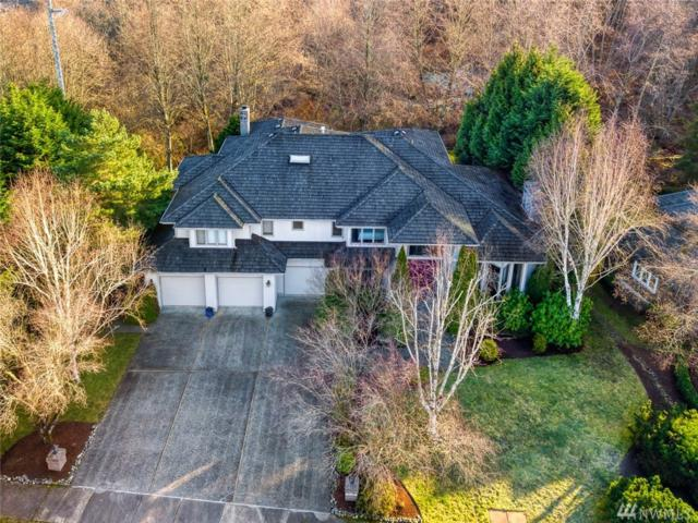6122 160th Ave SE, Bellevue, WA 98006 (#1400851) :: Keller Williams Western Realty