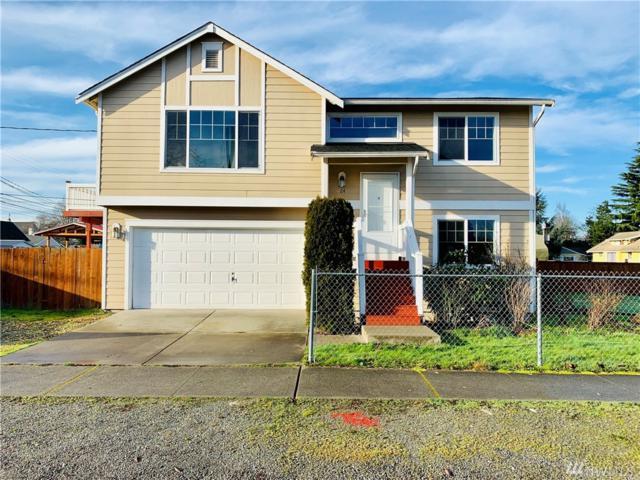 1124 E 34th St, Tacoma, WA 98404 (#1401280) :: Pickett Street Properties