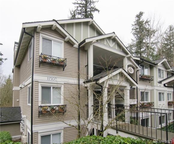 11307 NE 128th St G102, Kirkland, WA 98034 (#1401951) :: Icon Real Estate Group