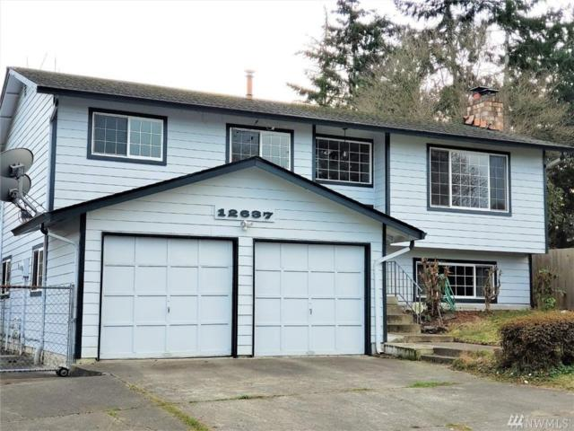 12637 SE 215th St, Kent, WA 98031 (#1403696) :: Real Estate Solutions Group
