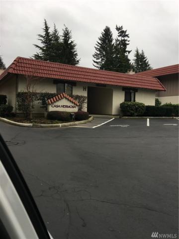 15701 NE 18th H-4, Bellevue, WA 98008 (#1404018) :: Homes on the Sound