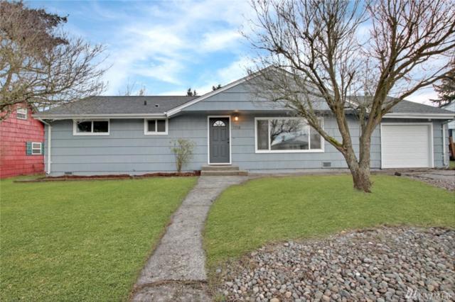 1116 E 64th St, Tacoma, WA 98404 (#1405143) :: KW North Seattle