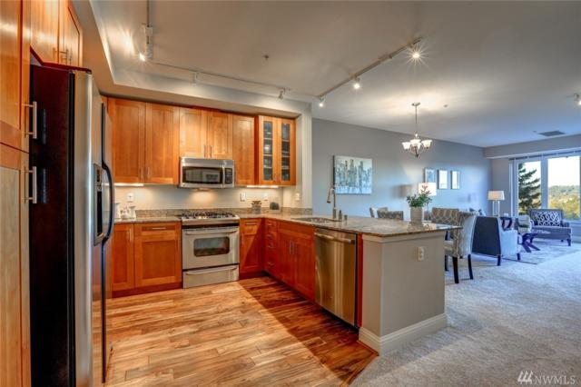 18707 SE Newport Wy #407, Issaquah, WA 98027 (#1405689) :: Better Homes and Gardens Real Estate McKenzie Group