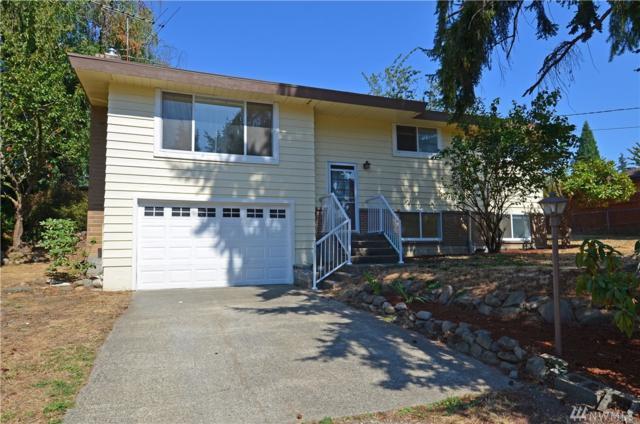 14424 SE 263rd St, Kent, WA 98042 (#1405784) :: KW North Seattle