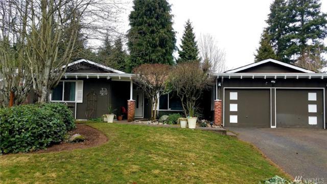 10714 NE 142nd St, Kirkland, WA 98034 (#1406690) :: KW North Seattle