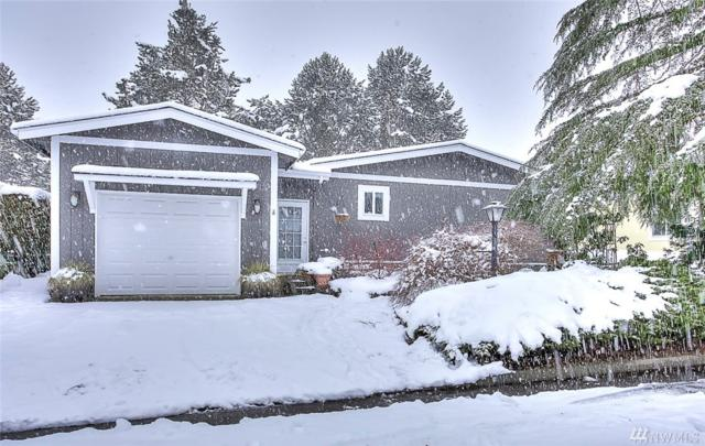 911 243rd St SW, Bothell, WA 98021 (#1409951) :: Homes on the Sound