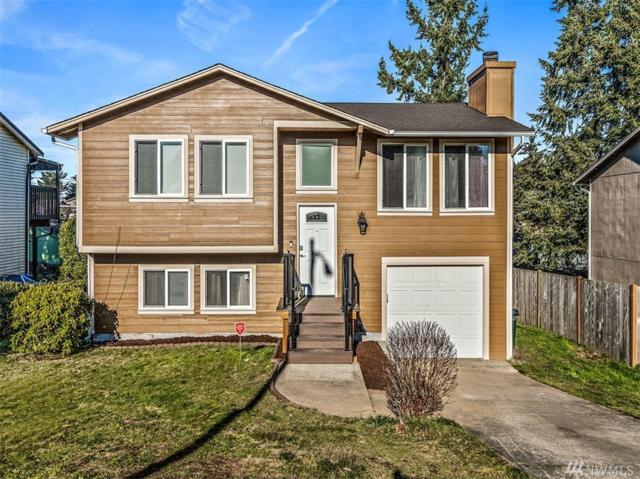1921 E 60th St, Tacoma, WA 98404 (#1412504) :: Homes on the Sound
