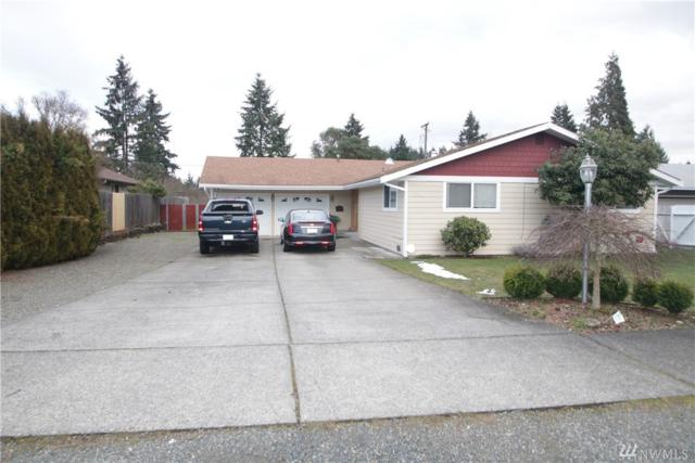 1213 S Highland Ave, Tacoma, WA 98465 (#1414505) :: Real Estate Solutions Group