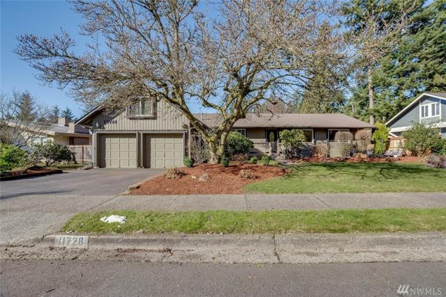 11728 NE 144th Place, Kirkland, WA 98034 (#1415662) :: Real Estate Solutions Group