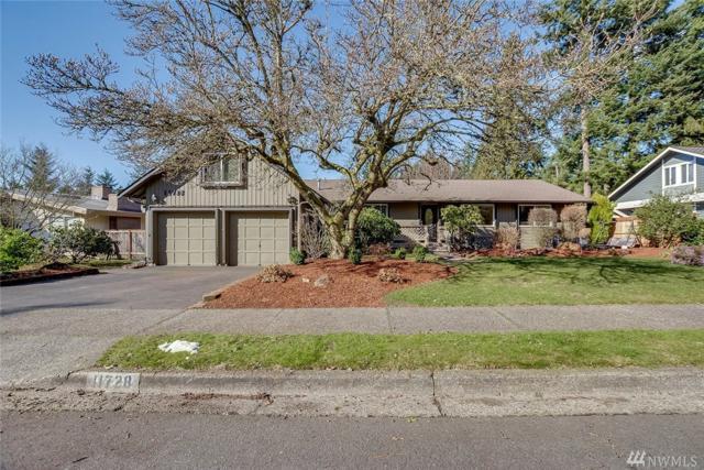11728 NE 144th Place, Kirkland, WA 98034 (#1415662) :: Ben Kinney Real Estate Team