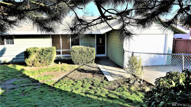 18404 49th Ave S, SeaTac, WA 98188 (#1417487) :: Real Estate Solutions Group